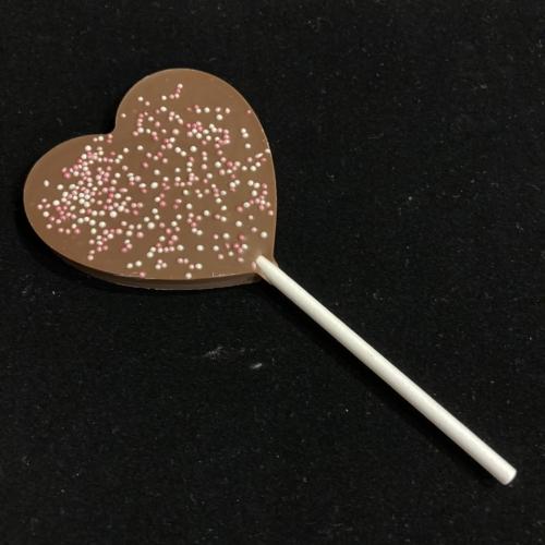 Tejcsokoládé nyalóka cukorpöttyel szív alakú